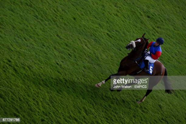 Amana ridden by Racheal Kneller come back down the course to the unsaddling area after the end of The download the Epsom iPhone app now apprentice...