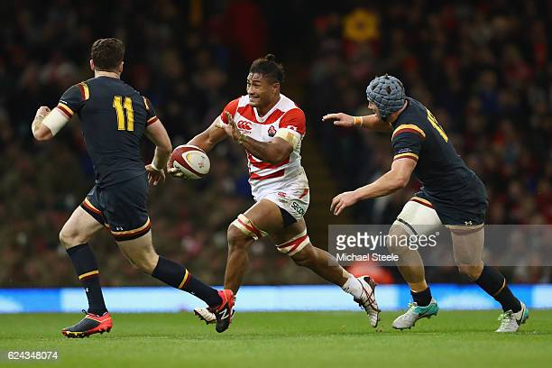 Amanaki Lelei Mafi of Japan cuts between Jonathan Davies and Alex Cuthbert of Wales during the International match between Wales and Japan at the...