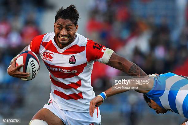 Amanaki Lelei Mafi of Japan hands off during the international friendly match between Japan and Argentina at Prince Chichibu Stadium on November 5...