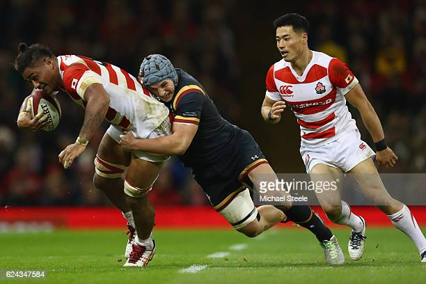 Amanaki Lelei Mafi of Japan is tackled by Jonathan Davies of Wales during the International match between Wales and Japan at the Principality Stadium...
