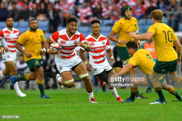 Amanaki Lelei Mafi of Japan is tackled by Reece Hodge of Australia during the international match between Japan and Australia at Nissan Stadium on...