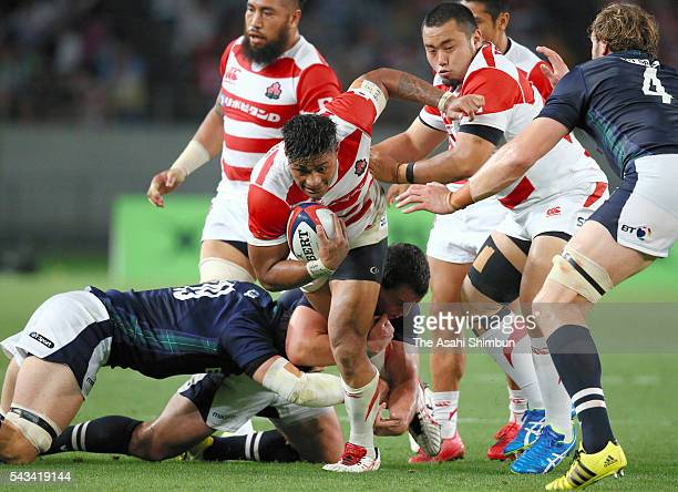 Amanaki Lelei Mafi runs with the ball during the international friendly match between Japan and Scotland at Ajinomoto Stadium on June 25 2016 in...