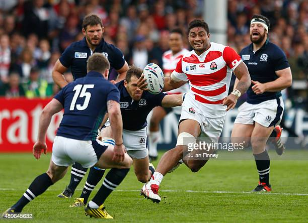 Amanaki Mafi of Japan breaks during the 2015 Rugby World Cup Pool B match between Scotland and Japan at Kingsholm Stadium on September 23 2015 in...