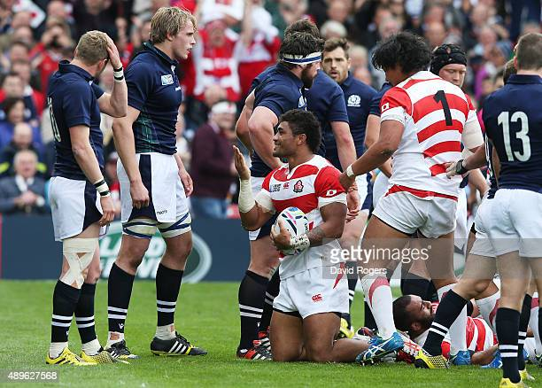 Amanaki Mafi of Japan celebrates scoring the opening try during the 2015 Rugby World Cup Pool B match between Scotland and Japan at Kingsholm Stadium...