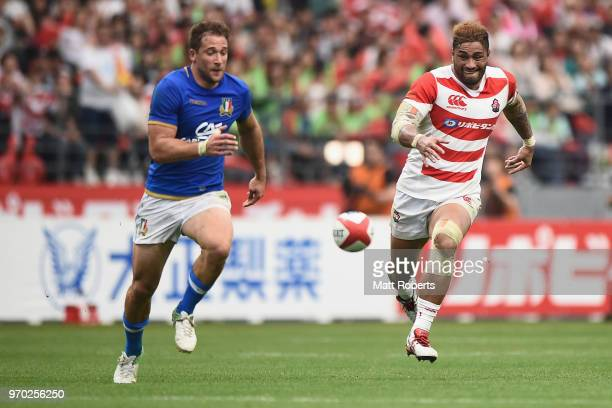 Amanaki Mafi of Japan competes for the ball against Tommaso Benvenuti of Italy during the Rugby international match between Japan and Italy at Oita...