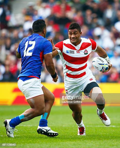 Amanaki Mafi of Japan hands off Johnny Leota of Samoa during the 2015 Rugby World Cup Pool B match between Samoa and Japan at Stadium mk on October 3...