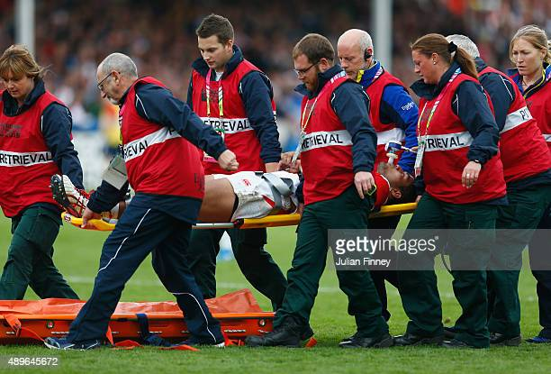 Amanaki Mafi of Japan leaves the field on a stretcher during the 2015 Rugby World Cup Pool B match between Scotland and Japan at Kingsholm Stadium on...