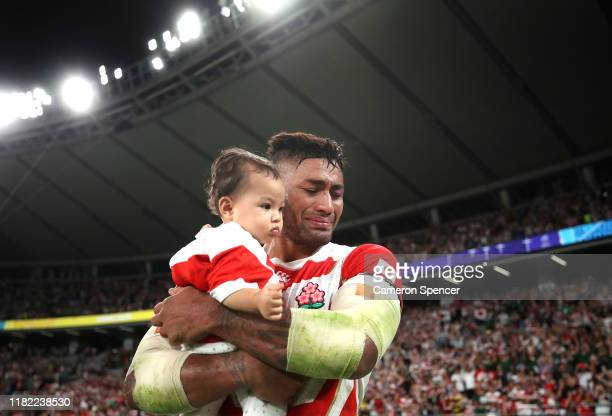 Amanaki Mafi of Japan tears up as he holds his child following defeat in the Rugby World Cup 2019 Quarter Final match between Japan and South Africa...