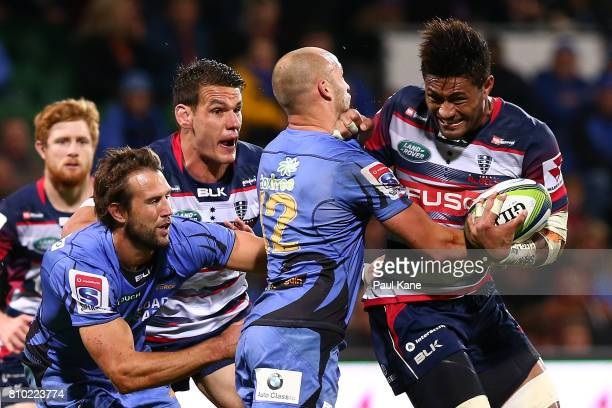 Amanaki Mafi of the Rebels attempts break from a tackle by Billy Meakes of the Force during the round 16 Super Rugby match between the Force and the...
