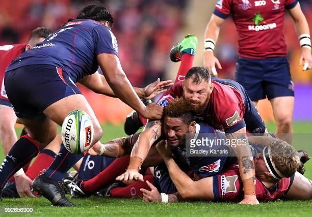 Amanaki Mafi of the Rebels clears the ball from the ruck during the round 18 Super Rugby match between the Reds and the Rebels at Suncorp Stadium on...