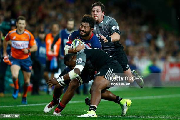 Amanaki Mafi of the Rebels is tackled by Manasa Mataele of the Crusaders during the round 14 Super Rugby match between the Rebels and the Crusaders...