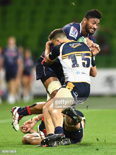 Amanaki Mafi of the Rebels is tackled by Tom Banks of the Brumbies during the round four Super Rugby match between the Rebels and the Brumbies at...