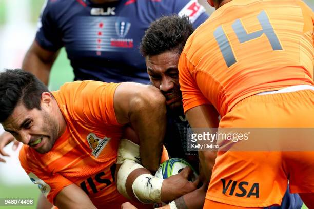 Amanaki Mafi of the Rebels runs with the ball while being is tackled by Jaguares defence during the round nine Super Rugby match between the Rebels...