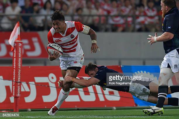 Amanaki Mafi runs with the ball during the international friendly match between Japan v Scotland at Ajinomoto Stadium on June 25 2016 in Tokyo Japan