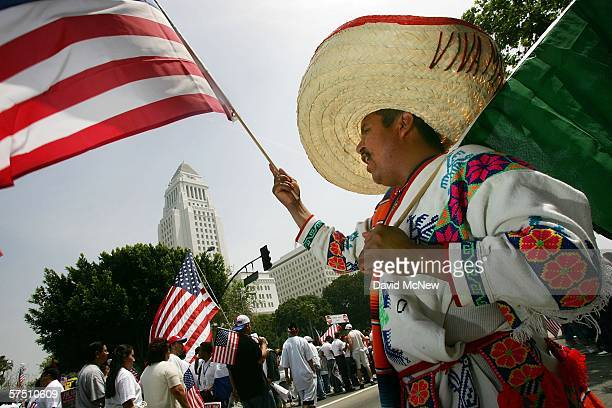 Amancia Vilchis of San Jose California waves his American and Mexican flags near City Hall during a rally on what is dubbed a Day Without Immigrants...