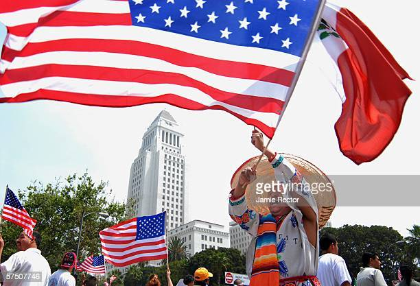 Amancio Vilchis from San Jose California waves a US and a Mexican flag while others march down Broadway in support of immigrant rights May 1 2006 in...