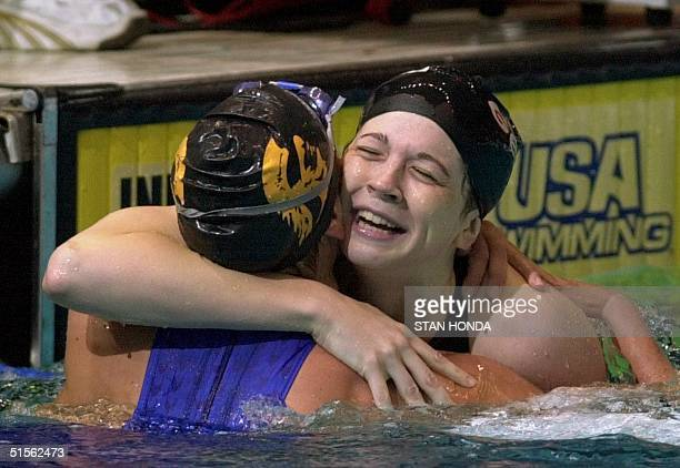 Amanda Adkins of the Athens Bulldogs is hugged by Lindsay Benko of the Trojan Swim Club after winning the women's 200meter backstroke final of the...