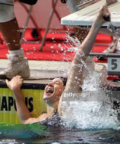 Amanda Adkins raises her arm after winning the women's 200meter backstroke final of the 2000 United States Olympic Swim Trials at the Indiana...