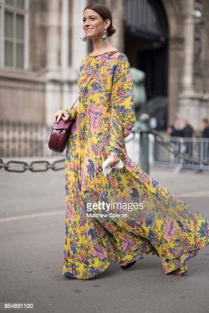 Amanda Alagem is seen attending Dries Van Noten during Paris Fashion Week wearing a yellow floral dress on September 27 2017 in Paris France