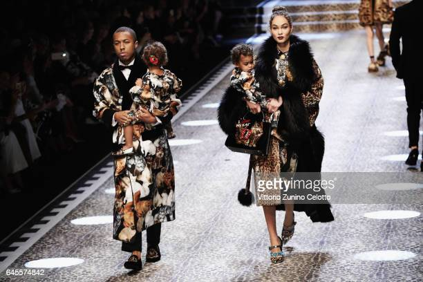 Amanda and Jason Harvey with their children Noah and Rose walk the runway at the Dolce Gabbana show during Milan Fashion Week Fall/Winter 2017/18 on...