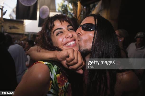 Amanda and Javi kissing at the Coco Loco bar at the Manumission closing party Ibiza 2001