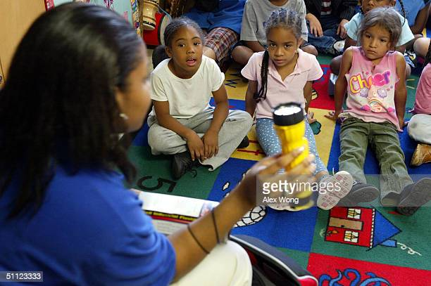 Amanda Anderson of Team DC shows a flashlight from a to go kit to students Kiara Moore Yarimar Figueroa and Cindi Umanzor as she conducts a...
