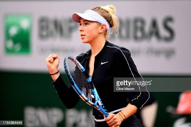 Amanda Anisimova of The United States celebrates during her ladies singles semifinal match against Ashleigh Barty of Australia during Day thirteen of...