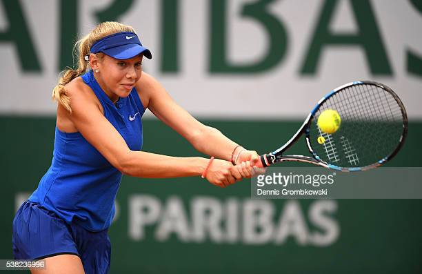 Amanda Anisimova of the United States hits a backhand during the Girls Singles final match against Rebeka Masarova of Switzerland on day fifteen of...