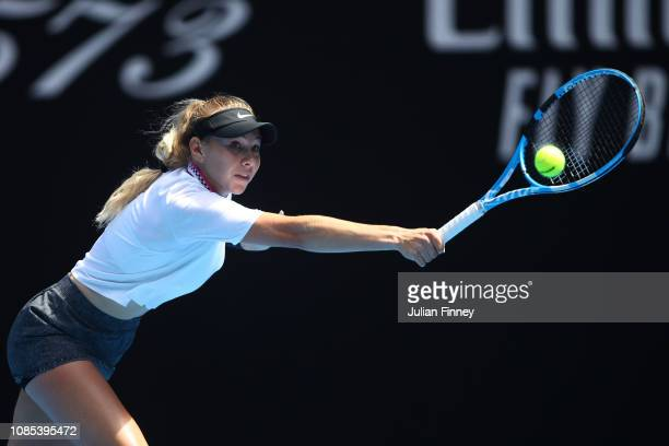 Amanda Anisimova of the United States plays a backhand in her fourth round match against Petra Kvitova of Czech Republic during day seven of the 2019...