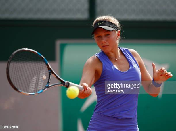 Amanda Anisimova of The United States plays a forehand during the ladies singles first round match against Kurumi Nara of Japan on day one of the...