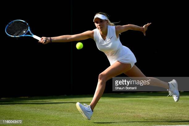 Amanda Anisimova of The United States plays a forehand in her Ladies' Singles second round match against Magda Linette of Poland during Day four of...