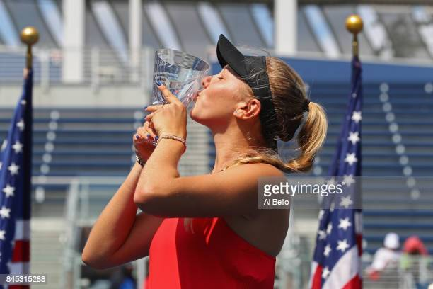 Amanda Anisimova of the United States poses with the championship trophy after she defeated Cori Gauff of the United States in their Junior Girls'...