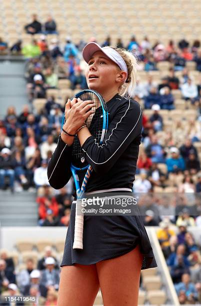 Amanda Anisimova of The United States reacts in her ladies singles semifinal match against Ashleigh Barty of Australia during Day thirteen of the...