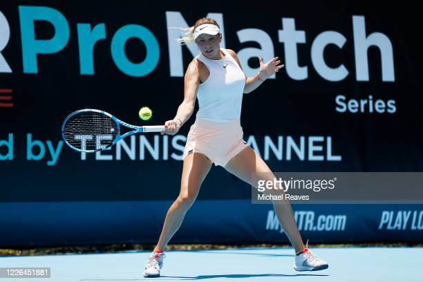 Amanda Anisimova of the United States returns a shot against Danielle Collins of the United States during the UTR Pro Match Series Day 1 on May 22,...