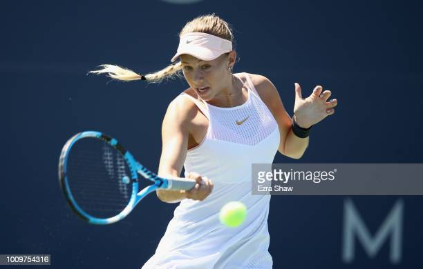 Amanda Anisimova of the United States returns a shot to Mihaela Buzarnescu of Romania during Day 4 of the Mubadala Silicon Valley Classic at Spartan...