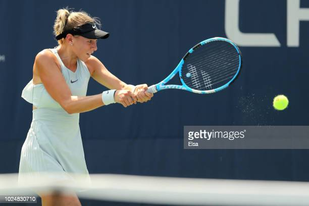Amanda Anisimova of the United States returns the ball during her women's singles first round match against Taylor Townsend of the United States on...
