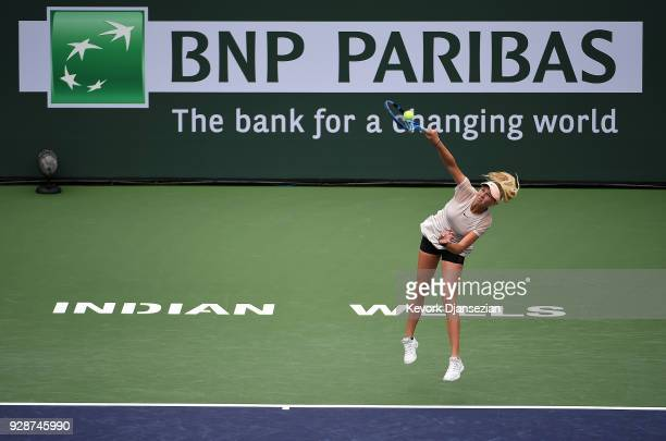 Amanda Anisimova of the United States serves against Pauline Parmentier of France during Day 3 of the BNP Paribas Open on March 7 2018 in Indian...
