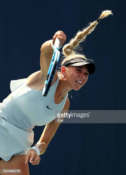 Amanda Anisimova of the United States serves the ball during her women's singles first round match against Taylor Townsend of the United States on...