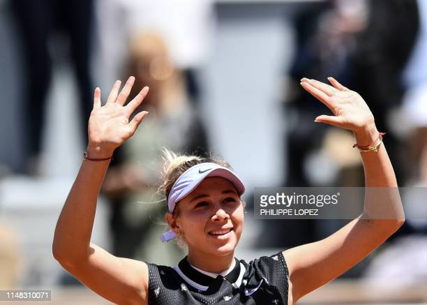 TOPSHOT Amanda Anisimova of the US celebrates after winning against Romania's Simona Halep at the end of their women's singles quarterfinal match on...