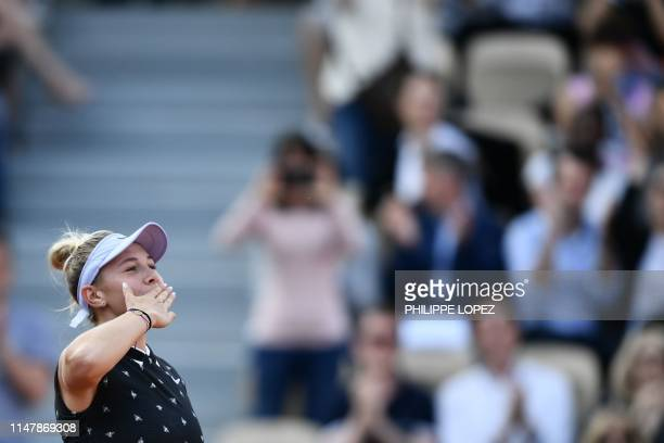 Amanda Anisimova of the US celebrates after winning against Spain's Aliona Bolsova during their women's singles fourth round match on day nine of The...