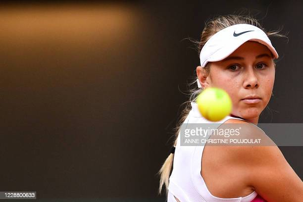 Amanda Anisimova of the US eyes the ball as she returns it to Bernarda Pera of the US during their women's singles second round tennis match at the...