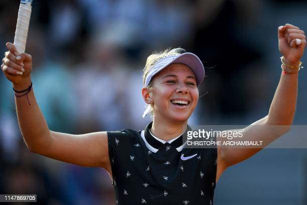 Amanda Anisimova of the US plays celebrates after winning against Spain's Aliona Bolsova during their women's singles fourth round match on day nine...