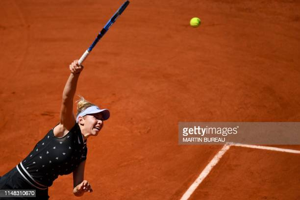 TOPSHOT Amanda Anisimova of the US serves the ball to Romania's Simona Halep during their women's singles quarterfinal match on day twelve of The...