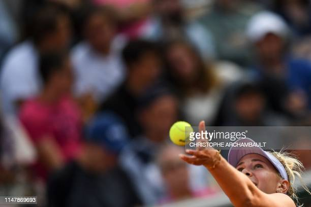 Amanda Anisimova of the US serves the ball to Spain's Aliona Bolsova during their women's singles fourth round match on day nine of The Roland Garros...