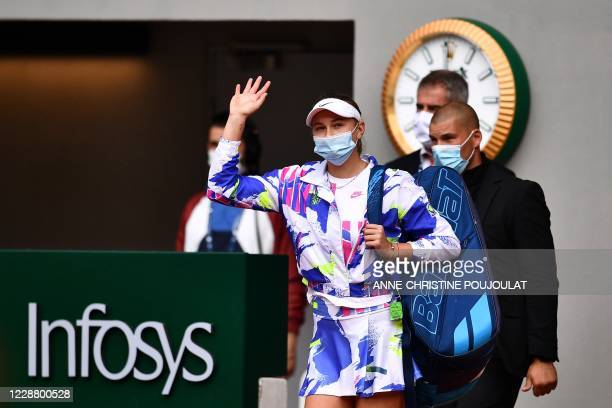 Amanda Anisimova of the US wears a protective facemask as she arrives at the Philippe Chatrier court for he women's singles second round tennis match...