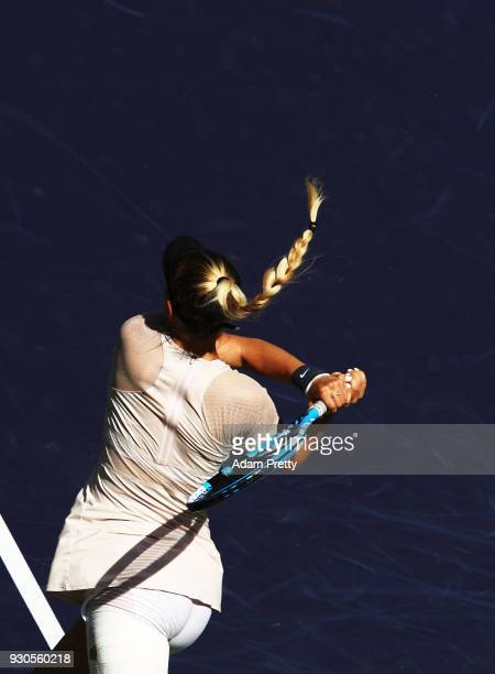 Amanda Anisimova of the USA hits a backhand during her match against Petra Kvitova during the BNP Paribas Open at the Indian Wells Tennis Garden of...