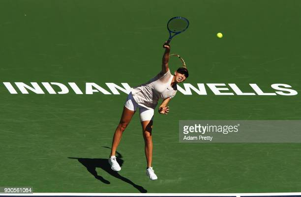 Amanda Anisimova of the USA serves during her match against Petra Kvitova of the Czech Republic during the BNP Paribas Open at the Indian Wells...