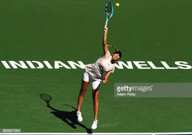 Amanda Anisimova of the USA serves during her match against Petra Kvitova during the BNP Paribas Open at the Indian Wells Tennis Garden of the Czech...