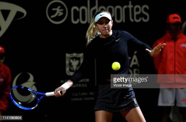 Amanda Anisimova of United States returns the ball against Sabine Lisicki of Germany as part of the WTA Claro Open Colsanitas 2019 at El Carmel Club...