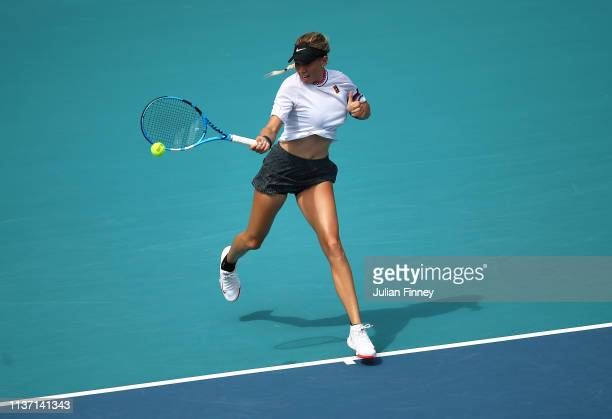Amanda Anisimova of USA in action against Andrea Petkovic of Germany during day three of the Miami Open tennis on March 20 2019 in Miami Gardens...